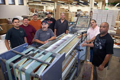 Albert Hererra and David Garcia bring quality binding to Printing Services products with the Heidelberg Saddle Stitcher